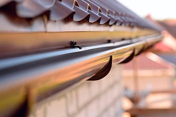 Ways to Maintain Your Roof's Drainage to Prevent Interior Home Moisture Intrusion