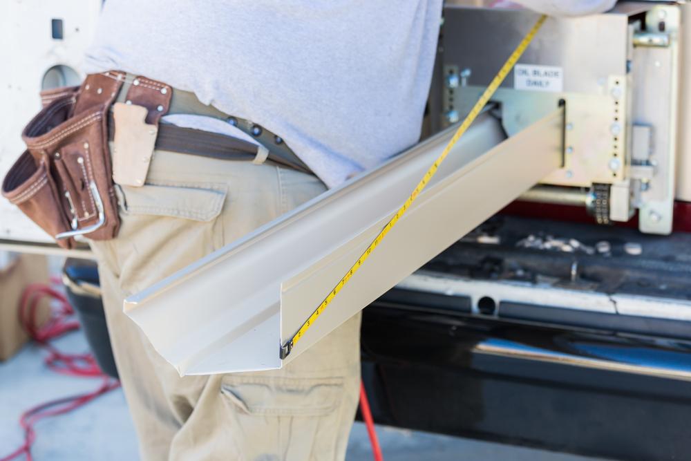 Image of D&B Guttering installing aluminum gutter