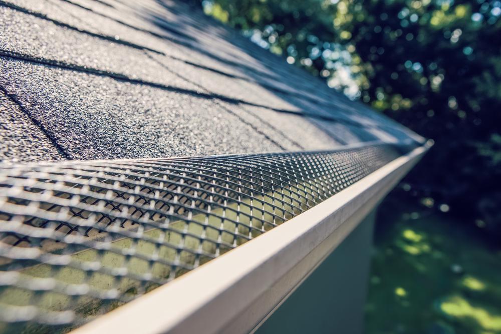 Image of D&B Guttering installing gutter covers